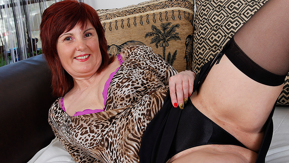 Sexy mature with her toys