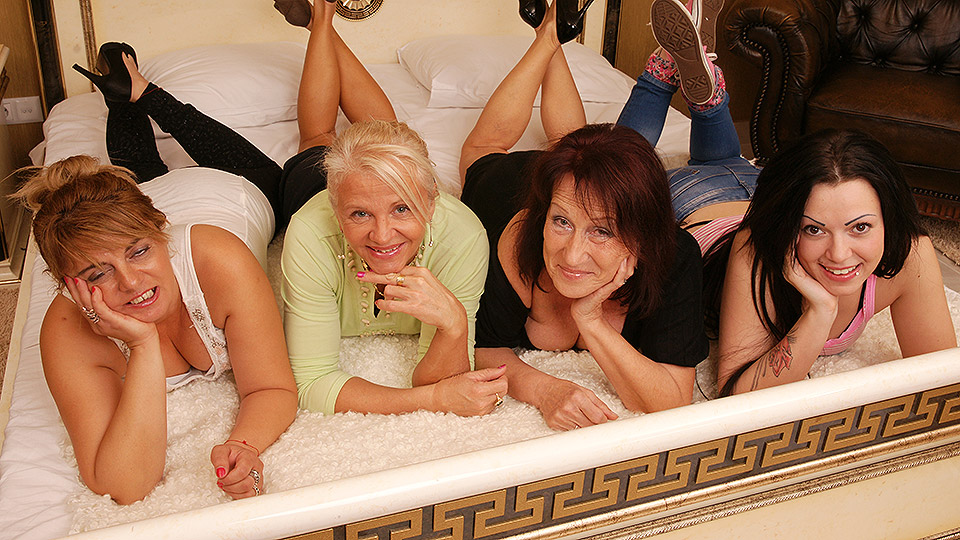 Four old and young lesbians making out on bed