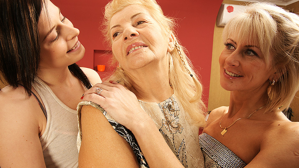 Three old and young lesbians have fun on the bed
