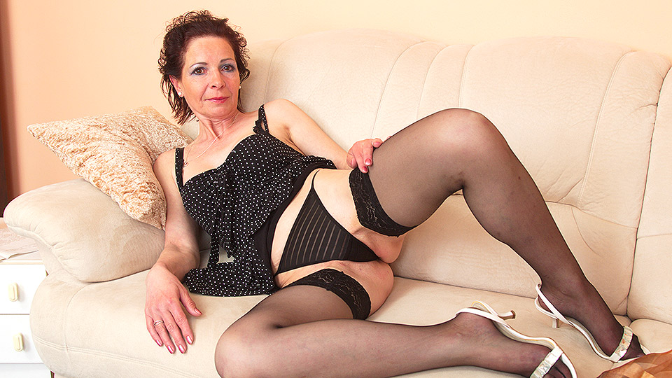 Naughty housewife playing with her fingers and her toy