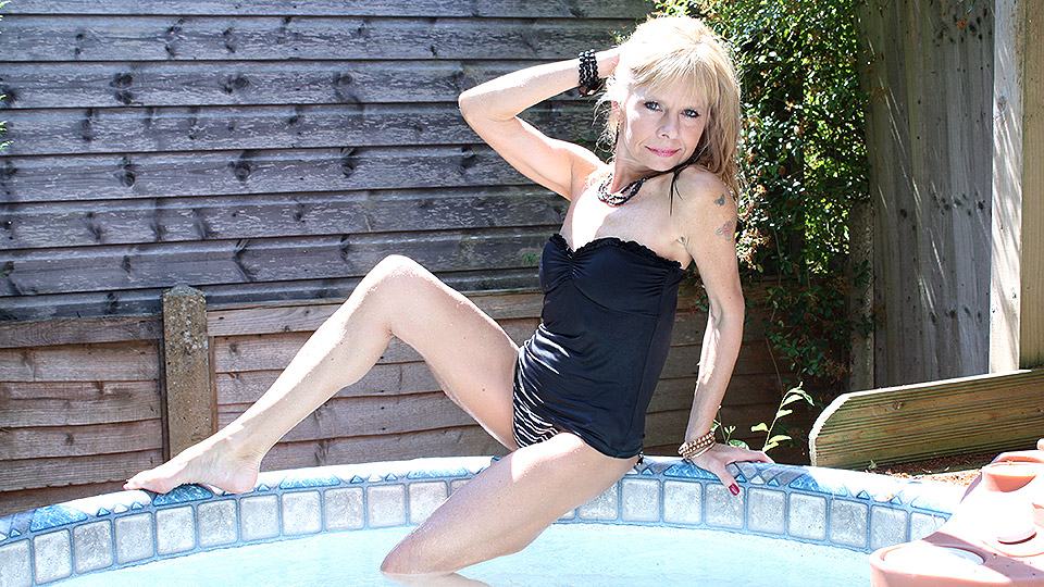 Naughty British housewife taking a dip in the hot tub