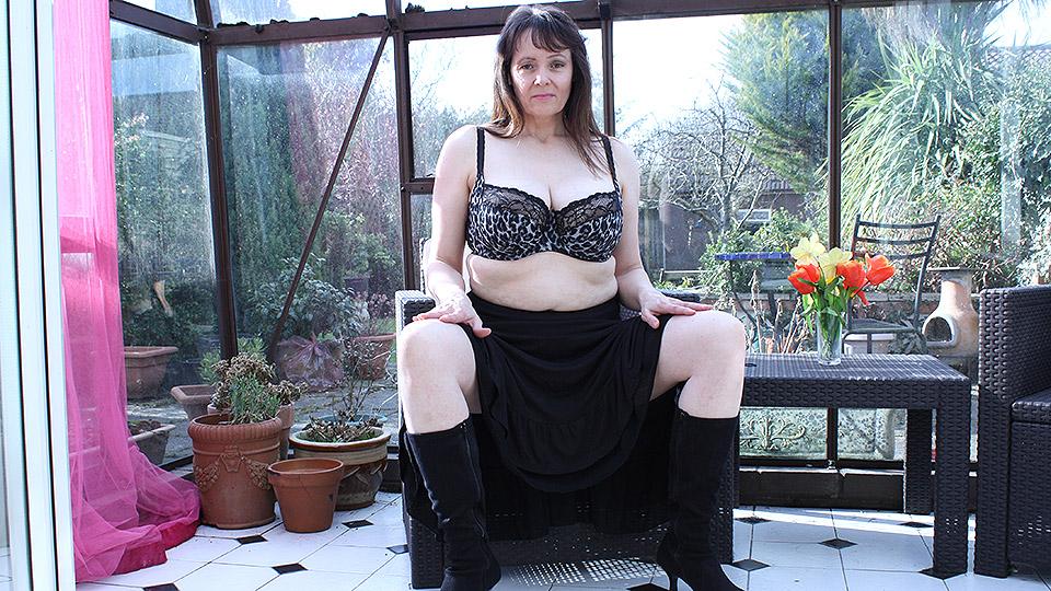 Big breasted British housewife masturbating in her gardenhouse