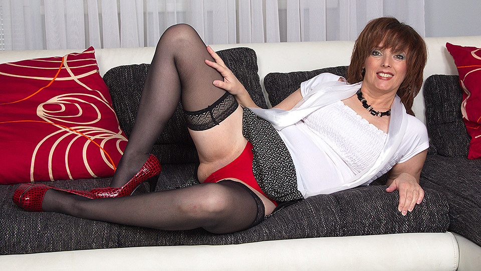Horny housewife playing with herself on the couch