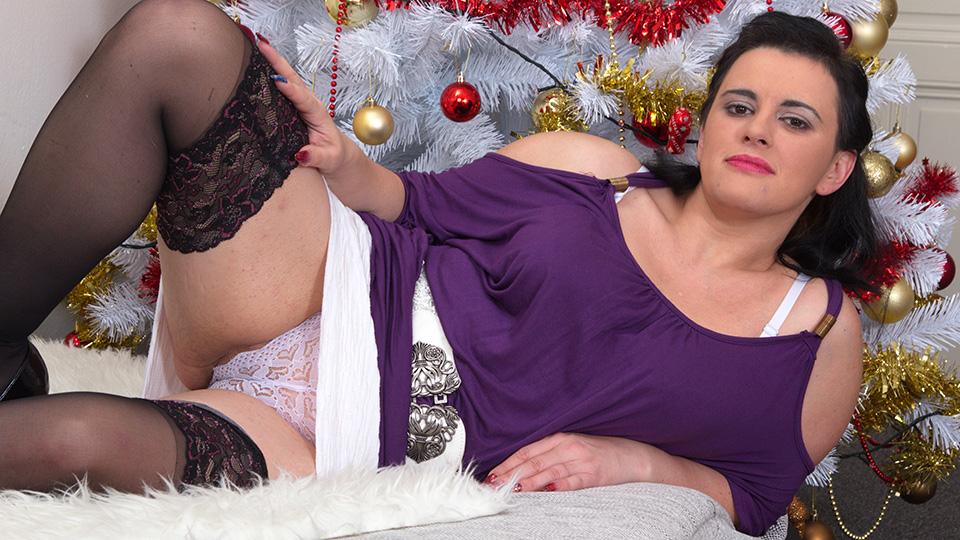 Naughty housewife masturbating under the christmas tree