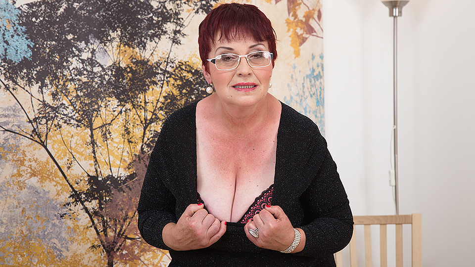 Horny grandma plays with her tits and hairy pussy