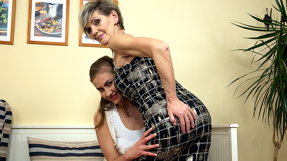 Hot old and young lesbian couple share a dildo