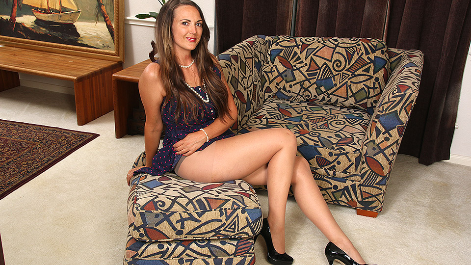 American housewife with long legs playing with her pussy