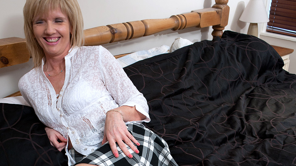 Horny English housewife and her dildo